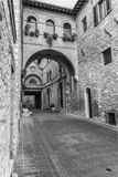 Assisi's secret alleys. Just around the corner form famous churches and squares, Assisi less known streets and alleys are full of beautiful surprises awaiting Stock Photography