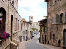 Assisi street. Medieval street in Assisi, Italy and the church San Pietro at the end stock image