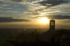 Assisi sunset. The silhouette of Basilica di Santa Chiara at sunset in Assisi, Perugia, Umbria, Italy Royalty Free Stock Photo