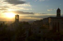 Assisi sunset. The silhouette of Basilica di Santa Chiara at sunset in Assisi, Perugia, Umbria, Italy Stock Photos