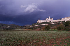 Assisi, Umbria,  Italy, Basilica of St. Francis, with storm and rainbow. Royalty Free Stock Photos