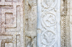 Assisi, Umbria, Italy- Stone carved decorations. Royalty Free Stock Images