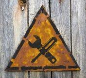 Assista il concetto su Rusty Warning Sign. Fotografia Stock Libera da Diritti