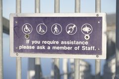 Assistance aid staff help sign for disabled blind deaf loop induction stock photos