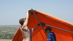 Assistance in the assembly of the hang glider stock video footage