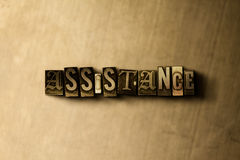 ASSISTANCE - close-up of grungy vintage typeset word on metal backdrop. Royalty free stock illustration.  Can be used for online banner ads and direct mail Royalty Free Stock Image