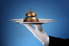 Assistance. Hotel reception service bell on a silver tray concept for assistance and support royalty free stock photography
