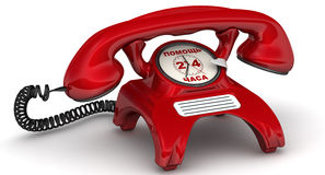 Assistance 24 hours. The inscription on the red phone. Red telephone with clock instead of disk dialer and inscription 'ASSISTANCE 24 HOURS' (Russian language) Royalty Free Stock Photos