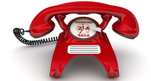 "Assistance 24 hours. The inscription on the red phone. Red telephone with clock instead of disk dialer and inscription ""ASSISTANCE 24 HOURS"" (Russian language) Stock Images"