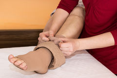 Assistance Putting On Some DVT Stockings Royalty Free Stock Photo