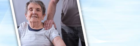 Assistance to elderly. panoramic banner. Comforting hand on shoulder of senior woman. panoramic banner royalty free stock images