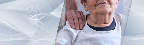 Assistance to elderly. panoramic banner. Comforting hand on shoulder of senior woman. panoramic banner royalty free stock photos