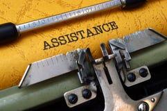 Assistance on typewriter Stock Photo
