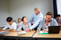 Assistance at university. Assistance of students at university with a teacher Royalty Free Stock Photography