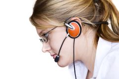 Assistant. Young woman with glasses taking your calls stock image