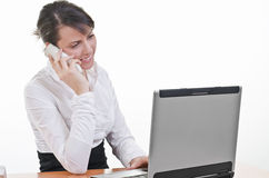 Assistant answering phone call Stock Photography