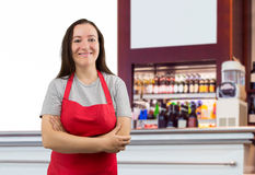 Assistant with apron at the cafe Royalty Free Stock Photography