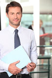 Assistant bringing folder Royalty Free Stock Image