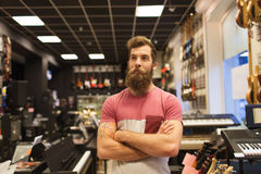Assistant or customer with beard at music store Stock Photos