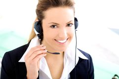 Assistant with headset. Blond young assistant smiling with a headset Royalty Free Stock Images