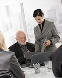 Assistant holding documents to sign for executive Royalty Free Stock Photo
