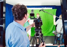 Assistant holds movie slate into the camera to start the production. Of a video piece royalty free stock images