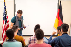 Assistant looks in his lecture material Stock Image