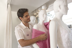 Assistant with Manikins Royalty Free Stock Images
