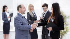 Assistant meets a businessman with a handshake. meetings and partnership. Photo with copy space stock images