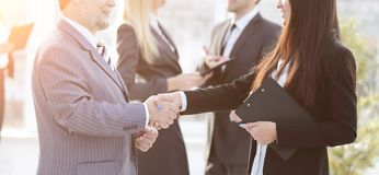 Assistant meets a businessman with a handshake. meetings and partnership. Photo with copy space royalty free stock image