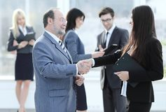 Assistant meets a businessman with a handshake. meetings and partnership. Photo with copy space royalty free stock photo