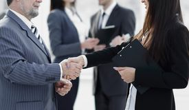 Assistant meets a businessman with a handshake. meetings and partnership. Photo with copy space stock image