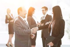Assistant meets a businessman with a handshake. meetings and partnership. Photo with copy space stock photos
