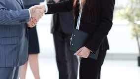 Assistant meets a businessman with a handshake. meetings and partnership. Photo with copy space stock photography