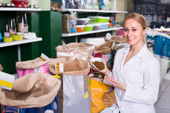 Assistant offering food for pets Stock Images