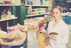 Assistant offering food for pets Stock Photography