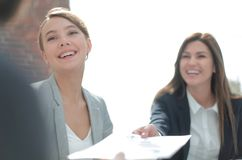 Assistant passes business woman working document. Assistant passes business women working document. office weekdays Royalty Free Stock Photography