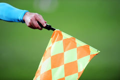 Assistant referee with flag up Stock Images