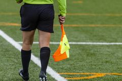 Assistant referee hold flag. closeup stock photo