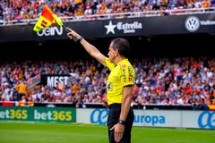 The assistant referee at the La Liga match between Valencia CF and FC Barcelona. VALENCIA, SPAIN - OCT 22: The assistant referee at the La Liga match between royalty free stock image