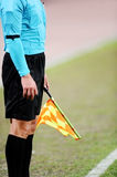 Assistant referee signaling with the flag Stock Photo