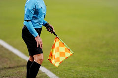 Assistant referee signaling with the flag Royalty Free Stock Photography
