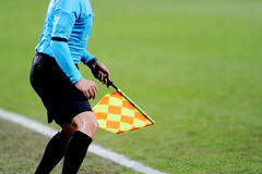 Assistant referee signaling with the flag Royalty Free Stock Photo