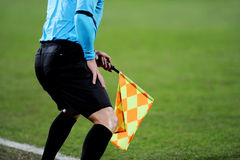Assistant referee signalling with the flag Royalty Free Stock Image