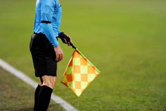 Assistant referee signalling with the flag Royalty Free Stock Photography