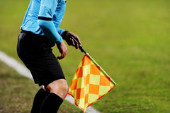 Assistant referee signalling with the flag Stock Images