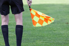 Assistant referees during a soccer match. Assistant referees in action during a soccer match Royalty Free Stock Photo
