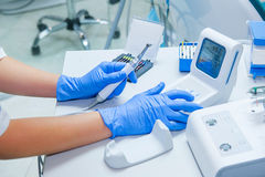 Free Assistant`s Hands Configures Dental Equipment In Dentist`s Office. Close Up, Selective Focus. Dentistry Royalty Free Stock Photos - 83157938