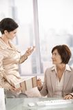 Assistant showing documents to businesswoman Royalty Free Stock Photo