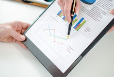 Assistant showing graphs to her boss Royalty Free Stock Photo